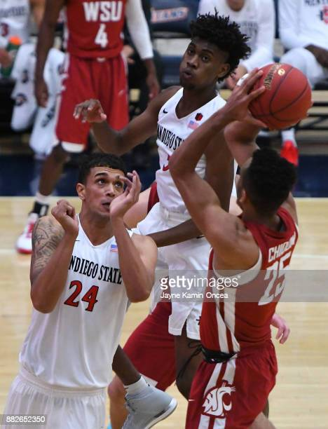 Nolan Narain of the San Diego State Aztecs defends a shot by Drick Bernstine of the Washington State Cougars during the championship game of the...