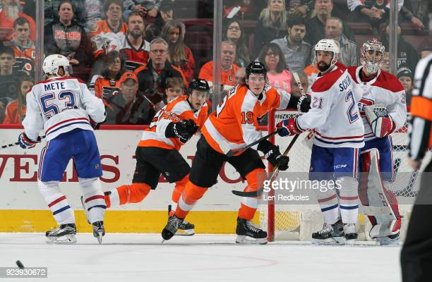 Nolan Patrick and Jordan Weal of the Philadelphia Flyers look to deflect a shot on goal against Victor Mete David Schlemko and Carey Price of the...