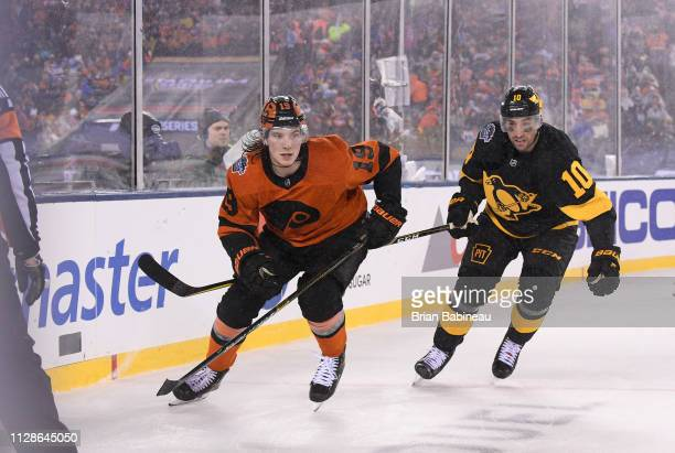 Nolan Patrick of the Philadelphia Flyers and Garrett Wilson of the Pittsburgh Penguins skate behind the net during the 2019 Coors Light NHL Stadium...