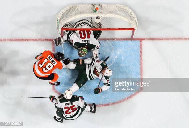Nolan Patrick of the Philadelphia Flyers battles in the crease against Jonas Brodin Greg Pateryn and Devan Dubnyk of the Minnesota Wild on January 14...
