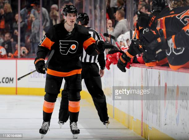 Nolan Patrick of the Philadelphia Flyers celebrates his goal with teammates on the bench after he scored in the third period against the Detroit Red...