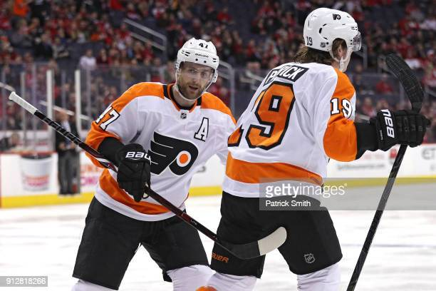 Nolan Patrick of the Philadelphia Flyers celebrates his goal with teammates Andrew MacDonald against the Washington Capitals during the first period...