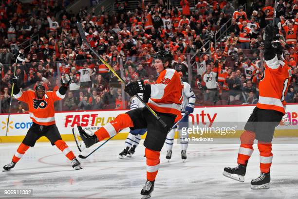 Nolan Patrick of the Philadelphia Flyers celebrates his third period goal against the Toronto Maple Leafs with Wayne Simmonds and Michael Raffl on...
