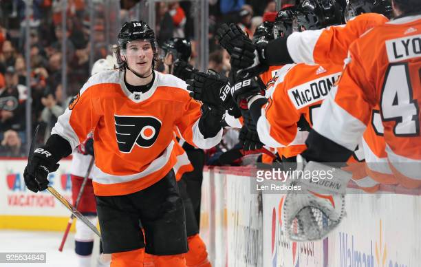 Nolan Patrick of the Philadelphia Flyers celebrates his third period powerplay goal against the Columbus Blue Jackets with teammates on the bench on...
