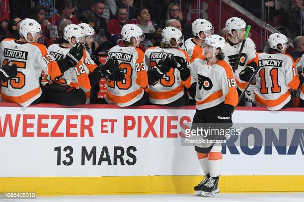 Nolan Patrick of the Philadelphia Flyers celebrates with the bench after scoring a goal against the Montreal Canadiens in the NHL game at the Bell...