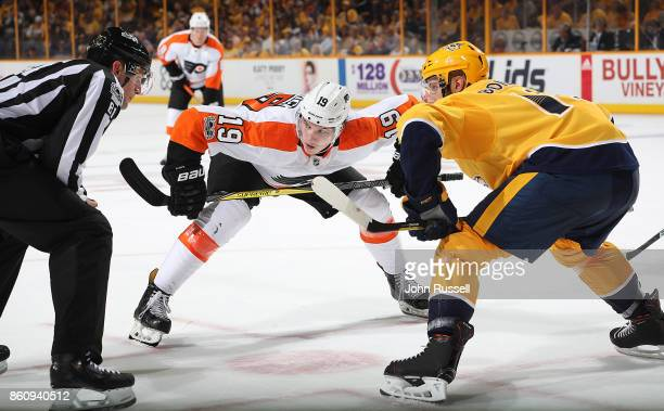 Nolan Patrick of the Philadelphia Flyers faces off against the Nashville Predators during an NHL game at Bridgestone Arena on October 10 2017 in...