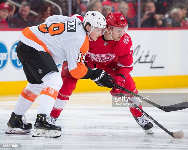 Nolan Patrick of the Philadelphia Flyers gets set for the faceoff next to Anthony Mantha of the Detroit Red Wings during an NHL game at Little...