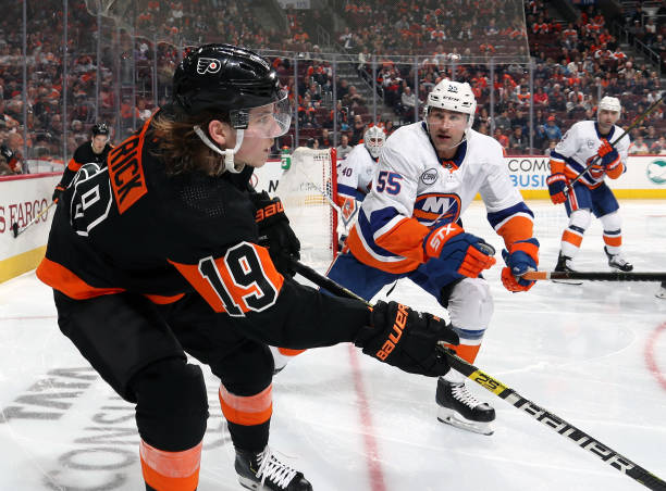 Nolan Patrick of the Philadelphia Flyers in action against Johnny Boychuk of the New York Islanders on March 23, 2019 at the Wells Fargo Center in...