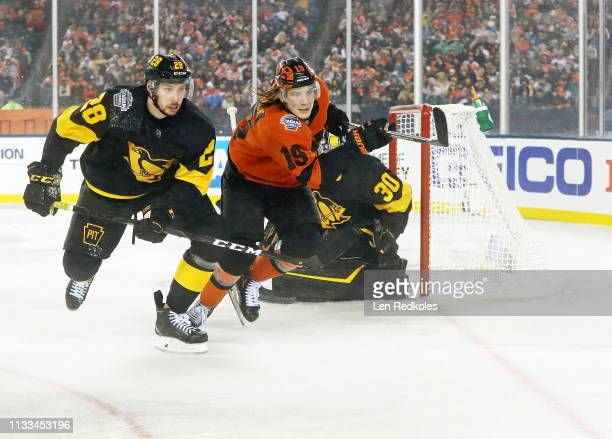 Nolan Patrick of the Philadelphia Flyers in action against Marcus Pettersson and Matt Murray of the Pittsburgh Penguins at the 2019 Coors Light NHL...
