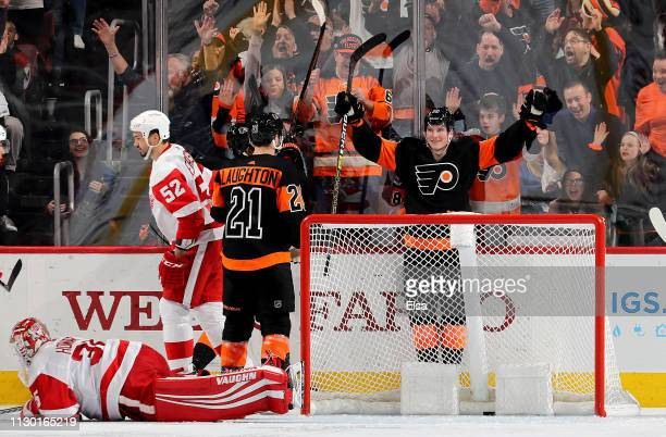Nolan Patrick of the Philadelphia Flyers is congratulated by teammate Scott Laughton after he scored a goal on Jimmy Howard of the Detroit Red Wings...