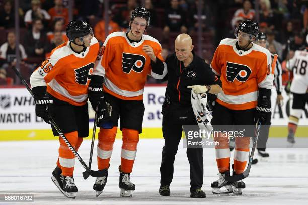 Nolan Patrick of the Philadelphia Flyers is helped off of the ice after being injured against the Anaheim Ducks during the second period at Wells...