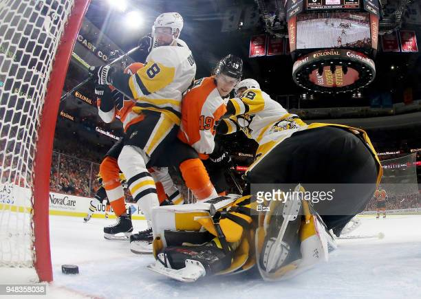 Nolan Patrick of the Philadelphia Flyers is unable to get the puck past Matt Murray and Brian Dumoulin of the Pittsburgh Penguins in the second...