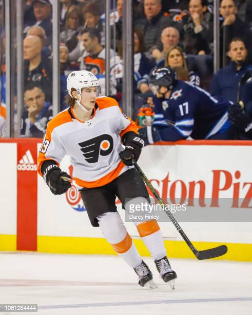 Nolan Patrick of the Philadelphia Flyers keeps an eye on the play during third period action against the Winnipeg Jets at the Bell MTS Place on...