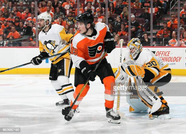 Nolan Patrick of the Philadelphia Flyers positions himself against Justin Schultz and Matthew Murray of the Pittsburgh Penguins in Game Six of the...