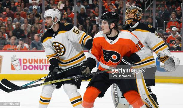 Nolan Patrick of the Philadelphia Flyers positions himself on a scoring opportunity against Adam McQuaid and Anton Khudobin of the Boston Bruins on...