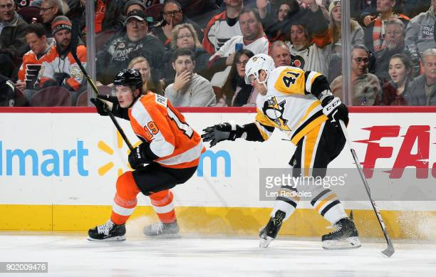 Nolan Patrick of the Philadelphia Flyers skates against Daniel Sprong of the Pittsburgh Penguins on January 2 2018 at the Wells Fargo Center in...