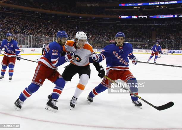 Nolan Patrick of the Philadelphia Flyers skates against Kevin Shattenkirk and Vinni Lettieri of the New York Rangers during the third period at...