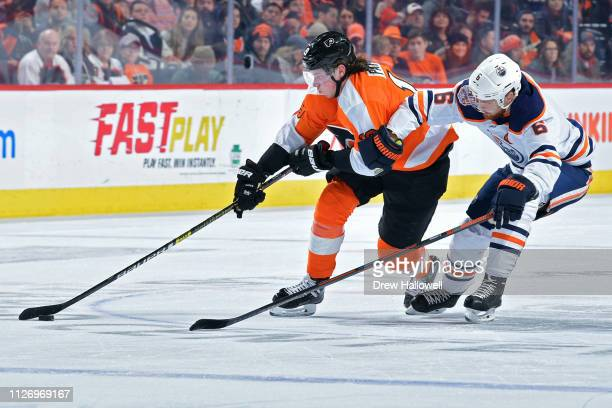 Nolan Patrick of the Philadelphia Flyers skates past Adam Larsson of the Edmonton Oilers at Wells Fargo Center on February 02 2019 in Philadelphia...