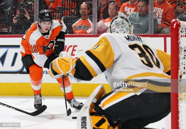 Nolan Patrick of the Philadelphia Flyers skates the puck in for a shot on goal against Matthew Murray of the Pittsburgh Penguins in Game Six of the...
