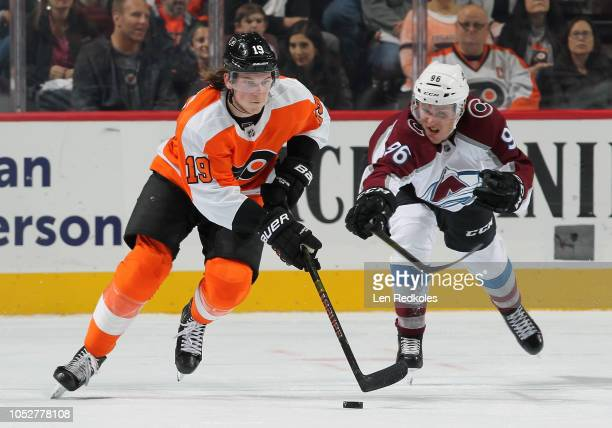 Nolan Patrick of the Philadelphia Flyers skates with puck while being pursued by Mikko Rantanen of the Colorado Avalanche on October 22 2018 at the...
