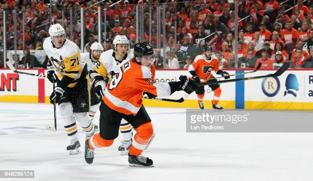Nolan Patrick of the Philadelphia Flyers takes a slapshot against Carl Hagelin Evgeni Malkin and Phil Kessel of the Pittsburgh Penguins in Game Three...