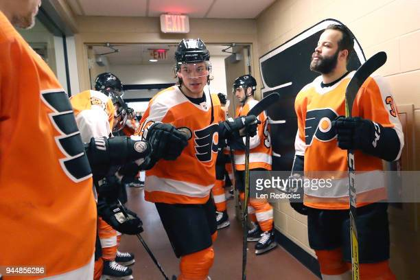 Nolan Patrick, Radko Gudas and Jori Lehtera of the Philadelphia Flyers prepare for warm-ups outside the locker room prior to playing the New York...