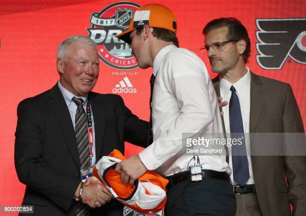 Nolan Patrick second overall pick of the Philadelphia Flyers shakes the hand of SVP Bobby Clarke of the Philadelphia Flyers during Round One of the...