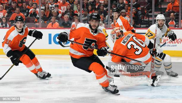 Nolan Patrick Shayne Gostisbehere Michal Neuvirth and Robert Hagg of the Philadelphia Flyers react to the play along the far boards against Bryan...
