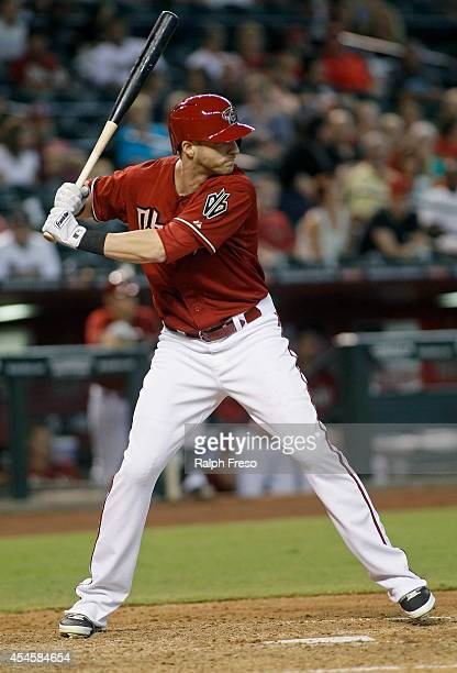Nolan Reimold of the Arizona Diamondbacks bats against the Colorado Rockies during the seventh inning of a MLB game at Chase Field on August 31 2014...