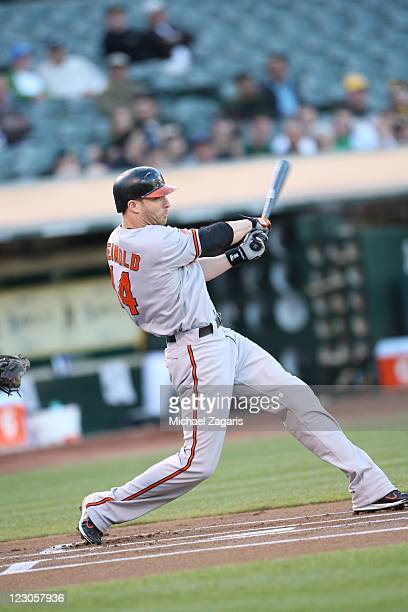 Nolan Reimold of the Baltimore Orioles bats during the game against the Oakland Athletics at the OaklandAlameda County Coliseum on August 16 2011 in...