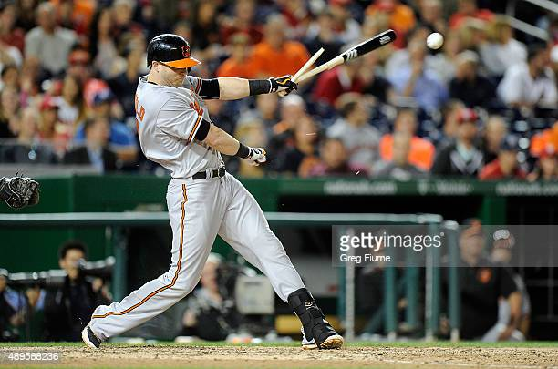 Nolan Reimold of the Baltimore Orioles breaks his bat on a ground out in the ninth inning against the Washington Nationals at Nationals Park on...