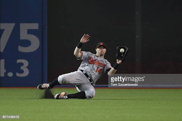 Nolan Reimold of the Baltimore Orioles catches a sinking line out to end the fifth inning during MLB game action against the Toronto Blue Jays on...
