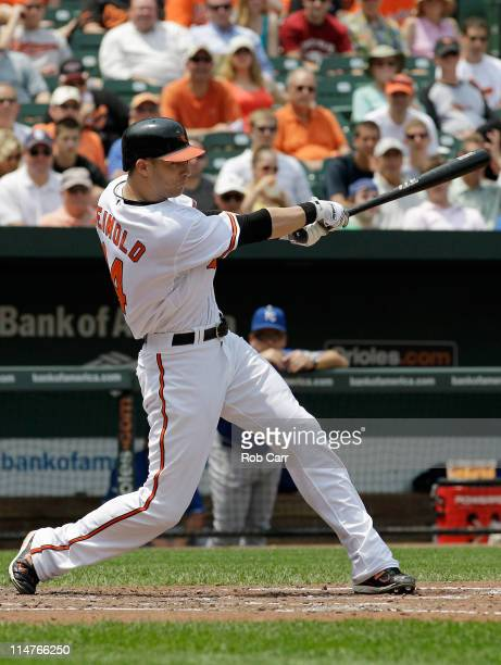 Nolan Reimold of the Baltimore Orioles hits a threerun home run against the Kansas City Royals during the third inning at Oriole Park at Camden Yards...