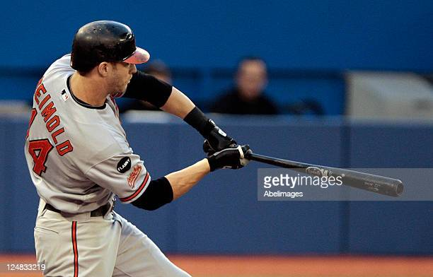 Nolan Reimold of the Baltimore Orioles hits during MLB action against the Toronto Blue Jays at the Rogers Centre September 9 2011 in Toronto Ontario...