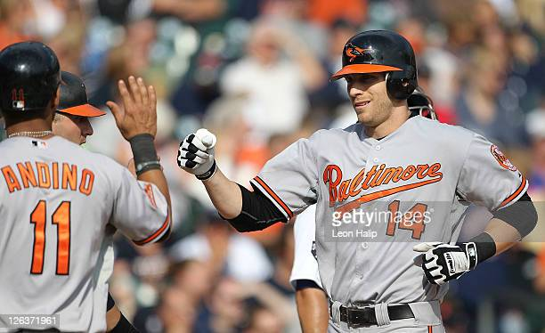 Nolan Reimold of the Baltimore Orioles is congradulated by Robert Andino after hitting a three run home run in the eighth inning during the game...