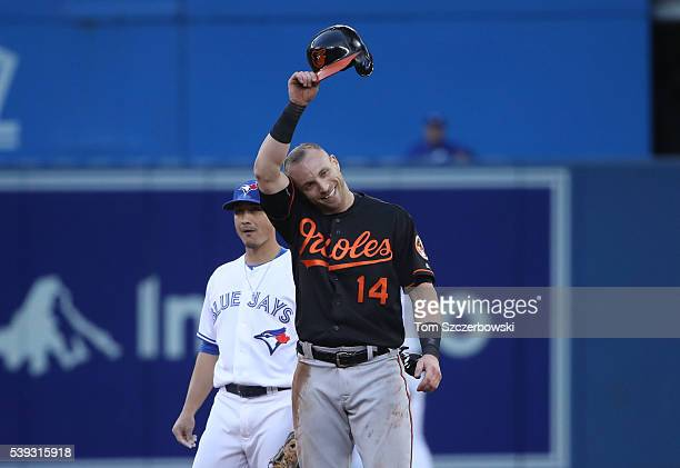 Nolan Reimold of the Baltimore Orioles reacts after being fooled by the hidden ball trick at second base in the fifth inning during MLB game action...