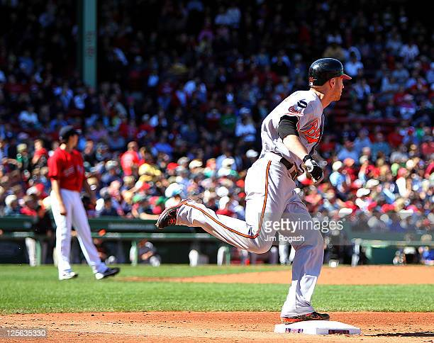 Nolan Reimold of the Baltimore Orioles rounds the bases after hitting a home run against the Boston Red Sox in the third inning at Fenway Park...
