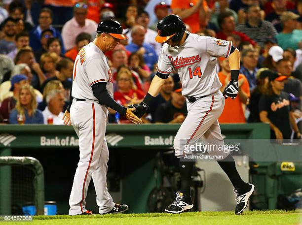 Nolan Reimold of the Baltimore Orioles rounds the bases after hitting a tworun home run in the second inning of a game against the Boston Red Sox at...
