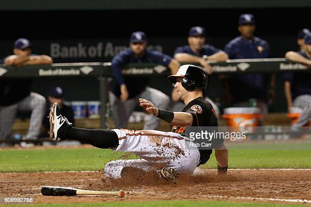 Nolan Reimold of the Baltimore Orioles scores a run in the eighth inning of the Orioles 54 win over the Tampa Bay Rays at Oriole Park at Camden Yards...