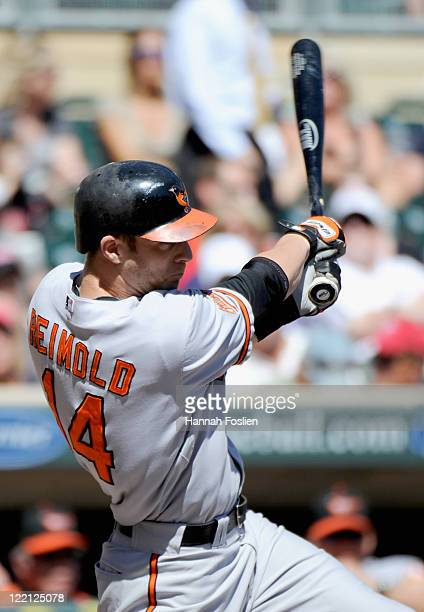 Nolan Reimold of the Baltimore Orioles singles in the first inning against the Minnesota Twins on August 25 2011 at Target Field in Minneapolis...