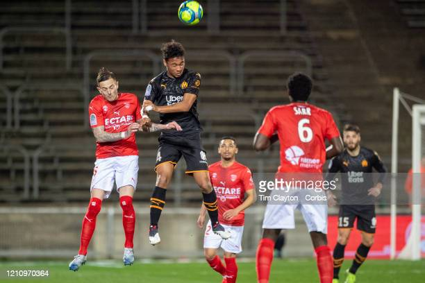 Nolan Roux of Nimes and Boubacar Kamara of Marseille challenge for the ball during the Nimes V Marseille French Ligue 1 regular season match at Stade...