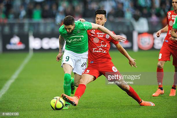 Nolan ROUX of Saint Etienne and Ramy BENSEBAINI of Montpellier during the French Ligue 1 match between AS SaintEtienne and Montpellier Herault SC at...