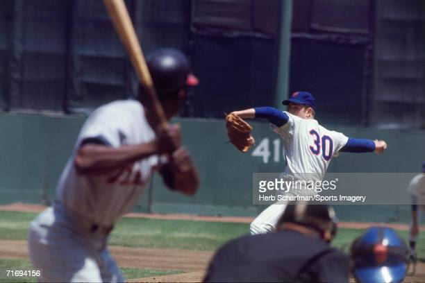 Nolan Ryan of the New York Mets pitches to Hank Aaron of the Atlanta Braves at Shea Stadium during a May 191968i in Flushing New York