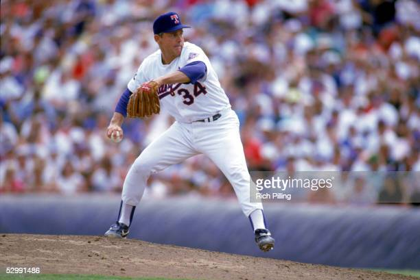 Nolan Ryan of the Texas Rangers pitches during a 1993 MLB game at The Ballpark in Arlington in Arlington, Texas.