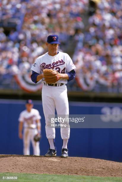 Nolan Ryan of the Texas Rangers stands on the mound during a 1993 MLB season game