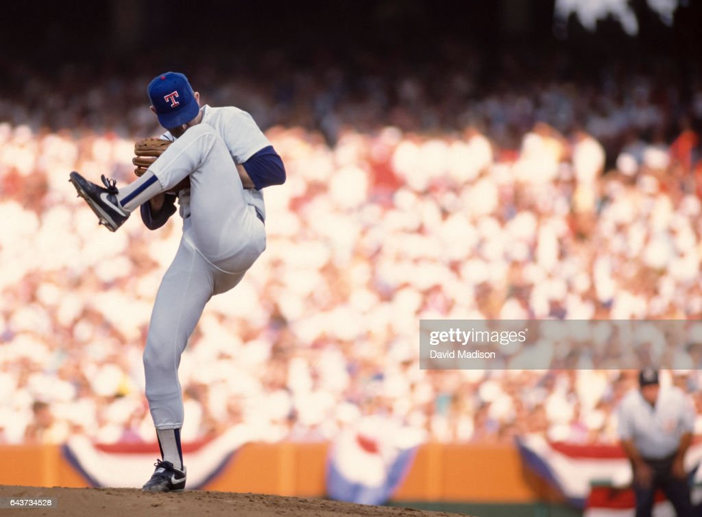 Nolan Ryan #34 of the Texas Rangers winds up before throwing a pitch in the Major League Baseball All-Star Game on July 11, 1989 at Anaheim Stadium in Anaheim, California.