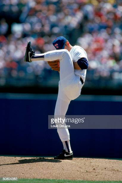 Nolan Ryan of the Texas Rangers winds up the pitch during a 1991 season game at The Ballpark in Arlington in Arlington, Texas.