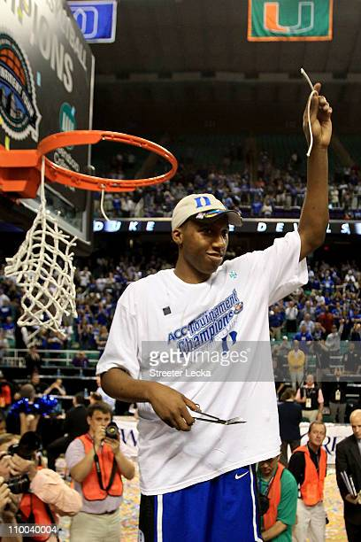 Nolan Smith of the Duke Blue Devils cuts down the net after defeating the North Carolina Tar Heels 75-58 in the championship game of the 2011 ACC...