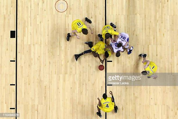 Nolan Smith of the Duke Blue Devils dives for the ball over Tim Hardaway Jr #10 of the Michigan Wolverines in the first half during the third round...