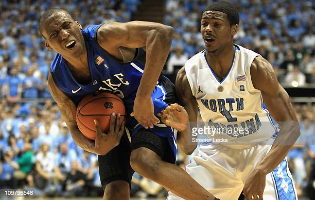 Nolan Smith of the Duke Blue Devils reacts to running into Dexter Strickland of the North Carolina Tar Heels during their game at the Dean E. Smith...
